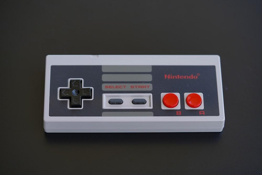 white and black nintendo game controller