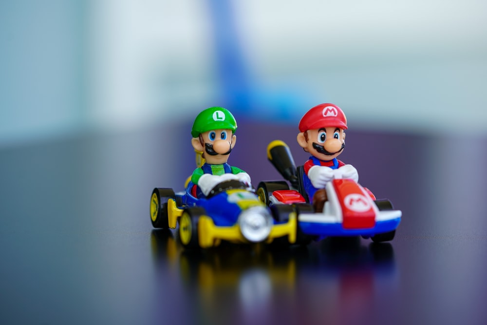 lego mini figure riding blue and red toy car