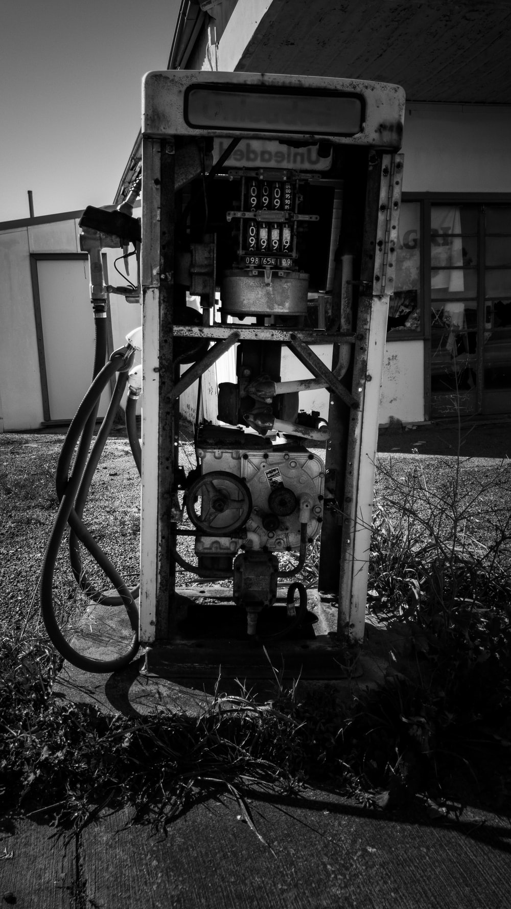 grayscale photo of metal machine