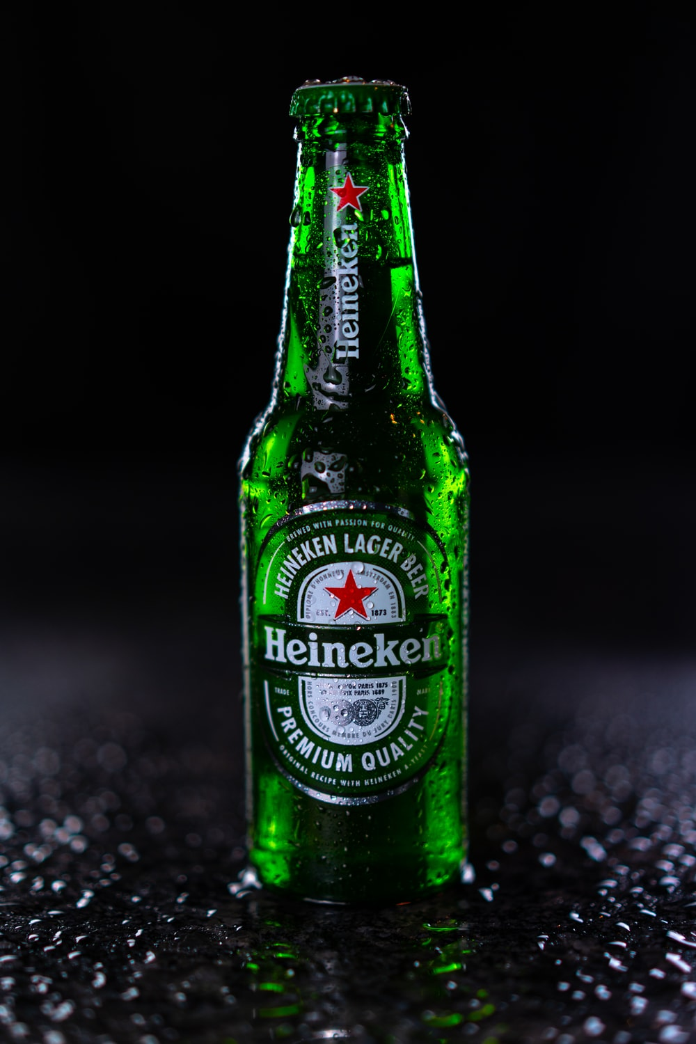 heineken bottle on black and white marble table