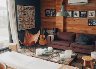 brown sofa near white coffee table