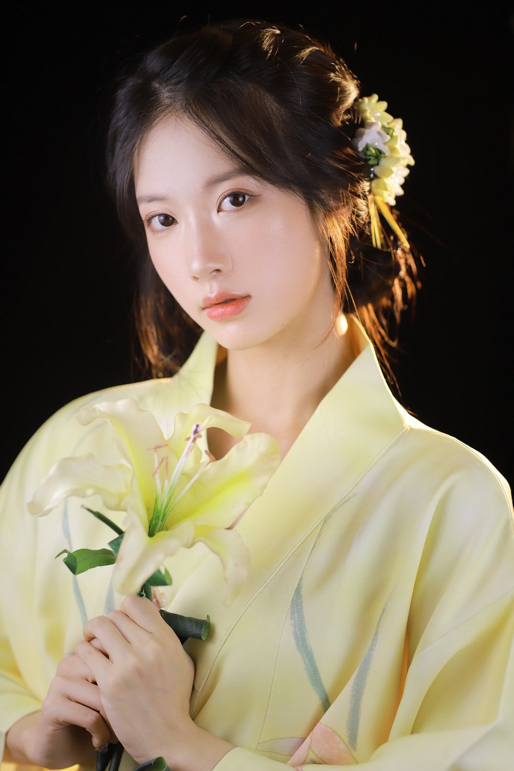woman in white dress shirt with white flower on ear
