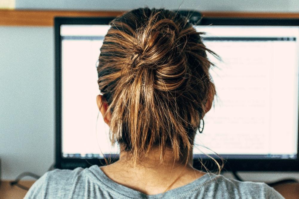woman in gray scoop neck shirt