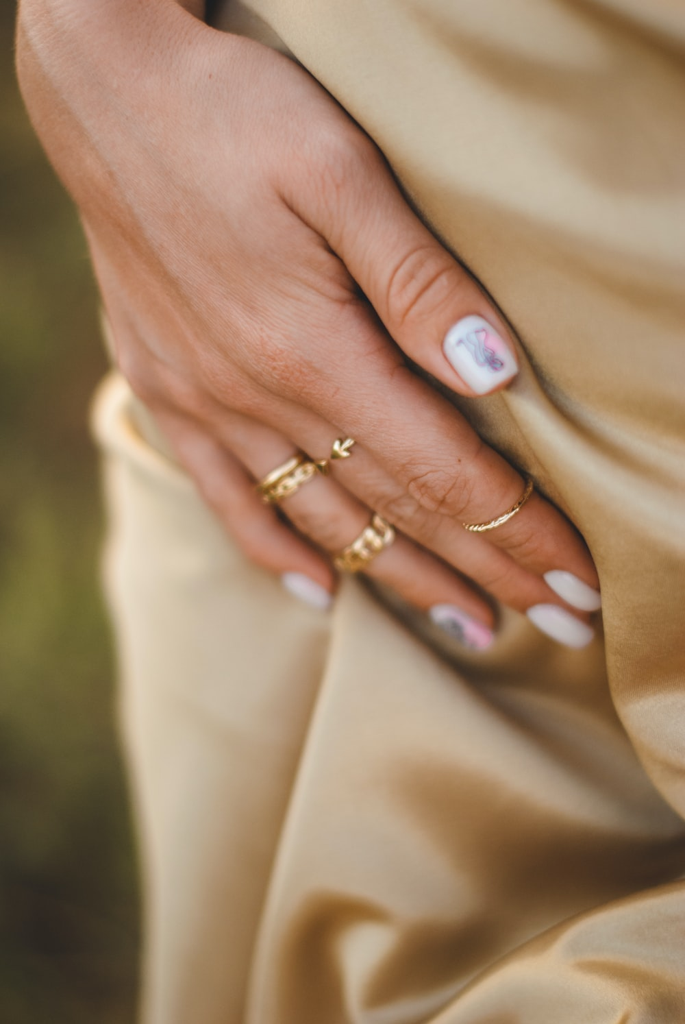 person wearing gold ring with blue stone
