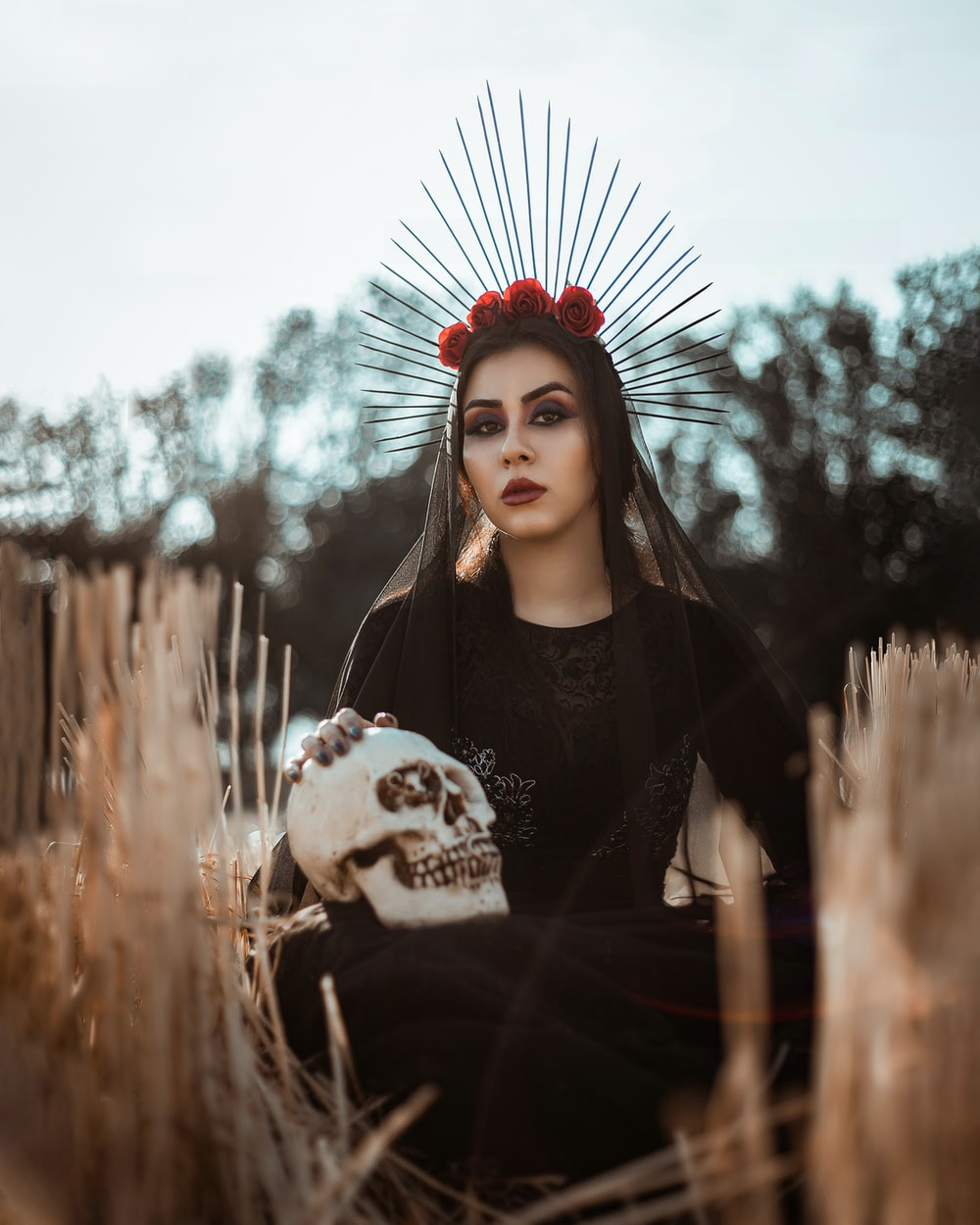 woman in black and white long sleeve shirt with red and white flower headdress