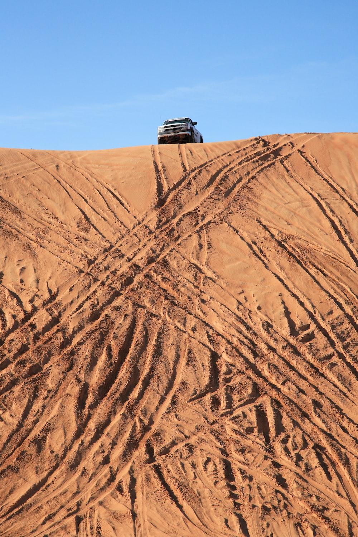 black suv on brown sand