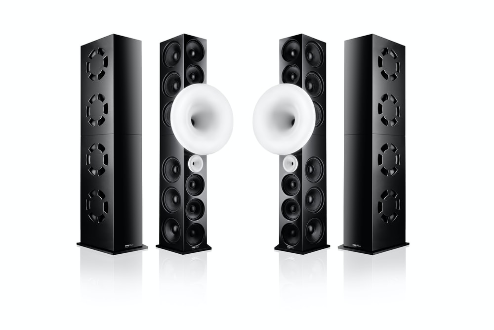 black and silver speakers on white surface