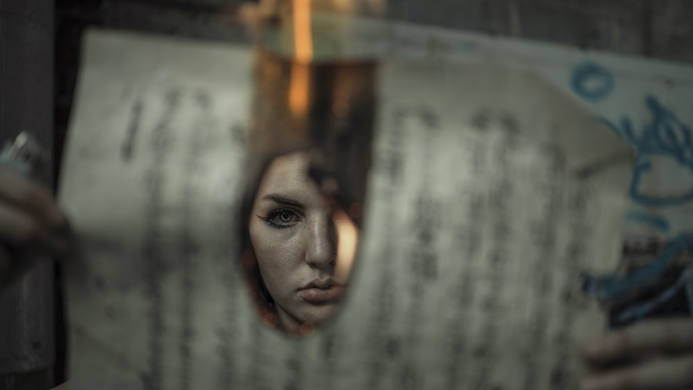 womans face on mirror
