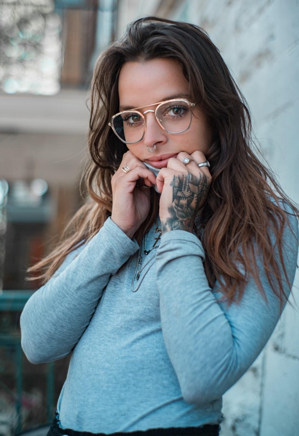 woman in blue sweater wearing eyeglasses