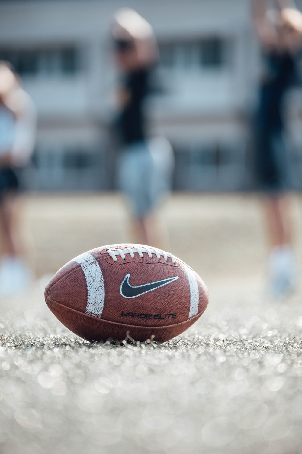 brown and white basketball on brown field