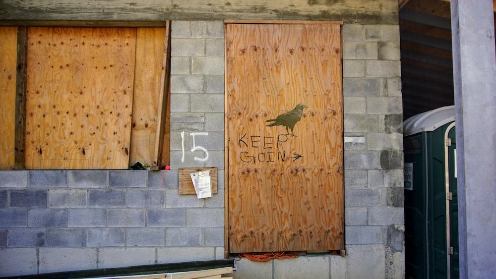 brown wooden door with i love you print