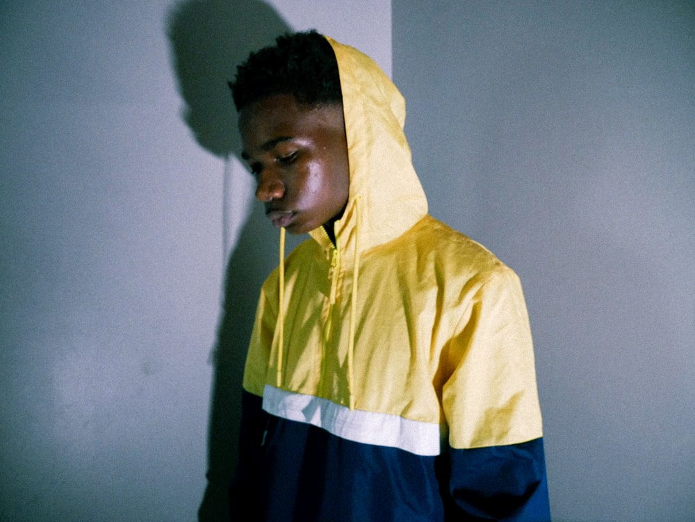 man in yellow and blue hoodie