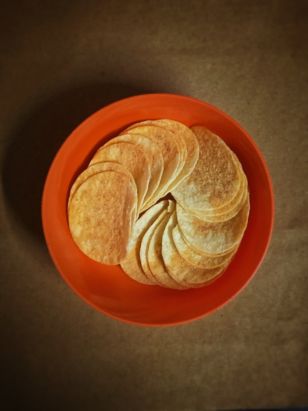 brown and white shell on orange round plate