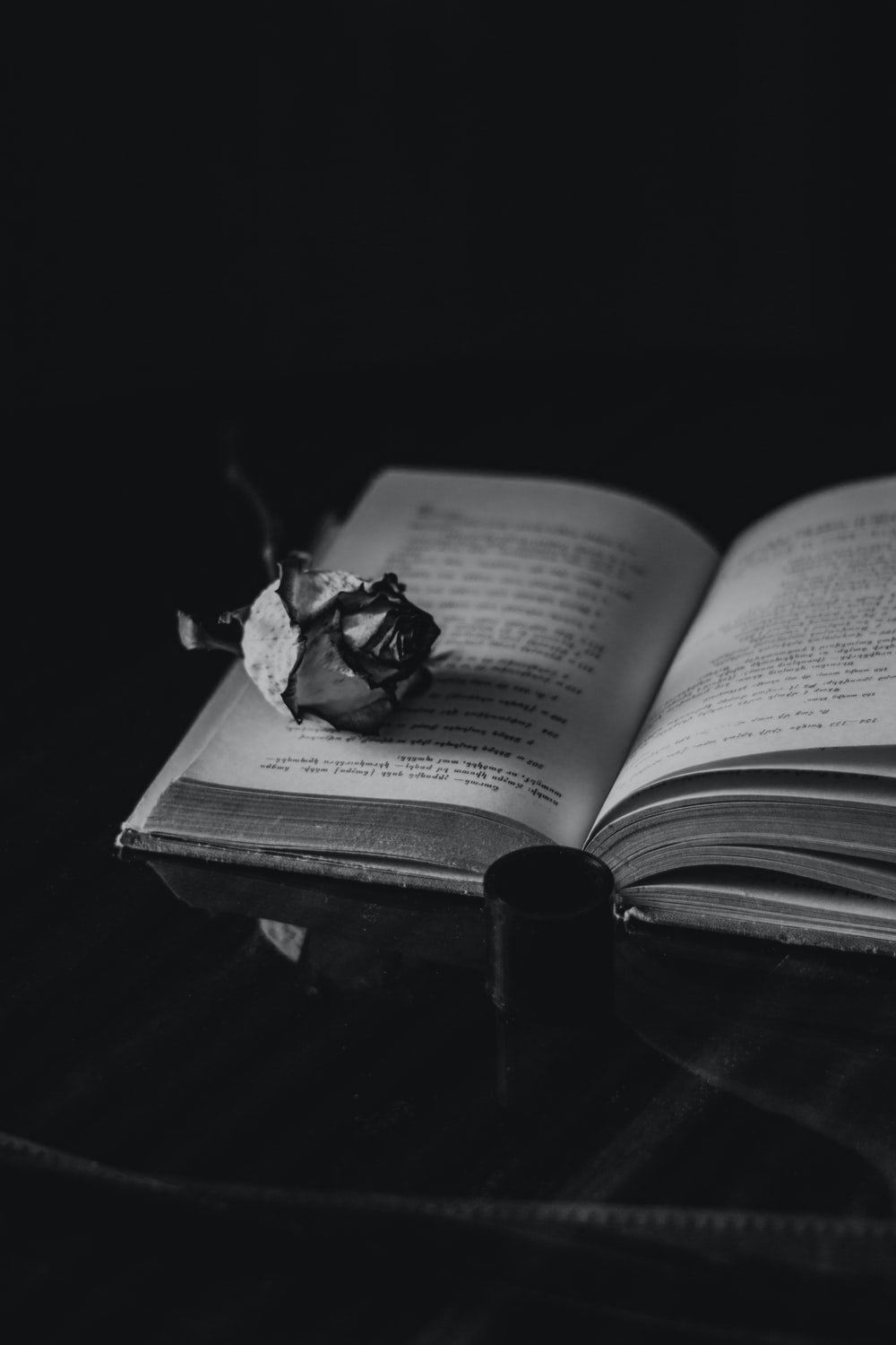 grayscale photo of opened book
