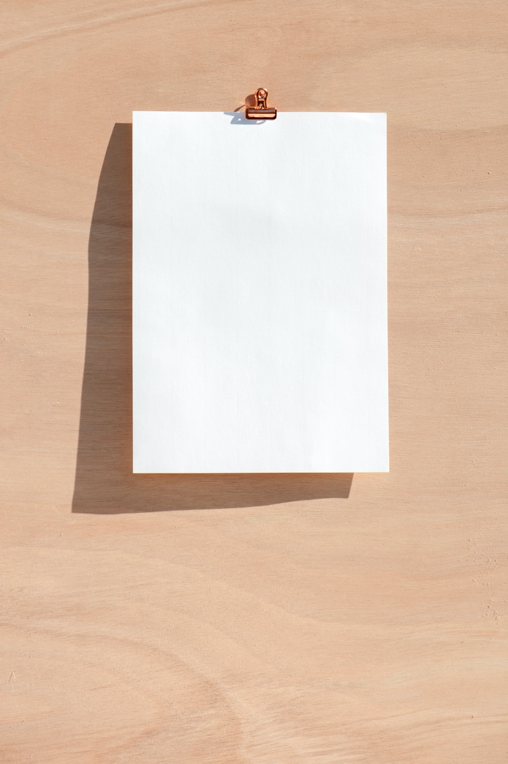 white printer paper on brown wooden table
