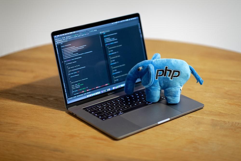 blue elephant figurine on macbook pro