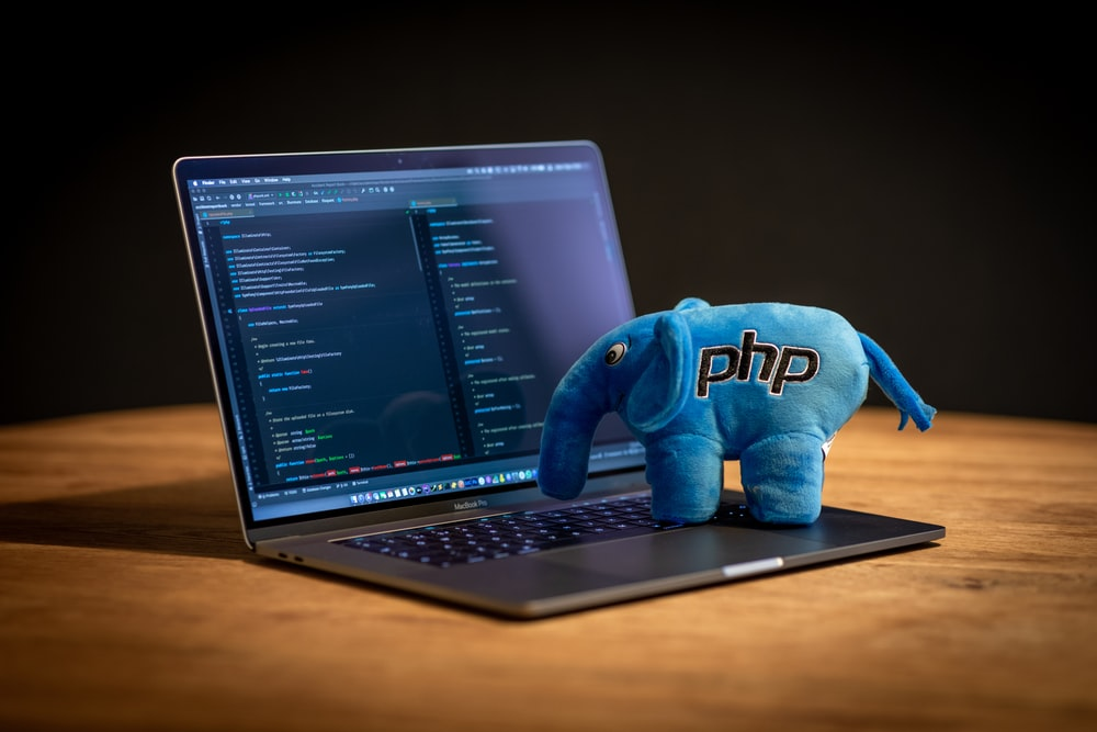 blue elephant plush toy on black laptop computer