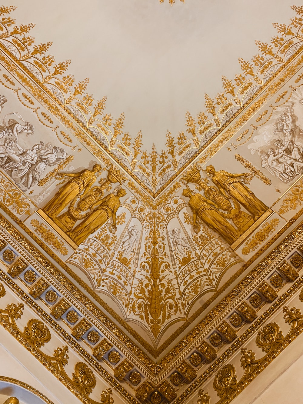gold and white floral textile