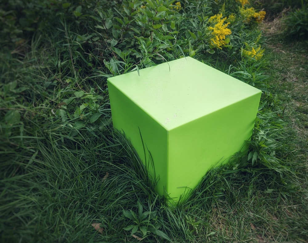 yellow box on green grass