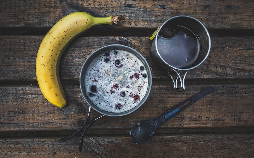 yellow banana fruit beside black cooking pot