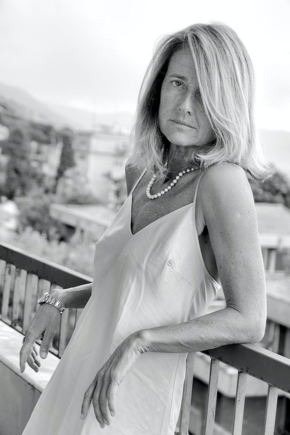 woman in white spaghetti strap dress