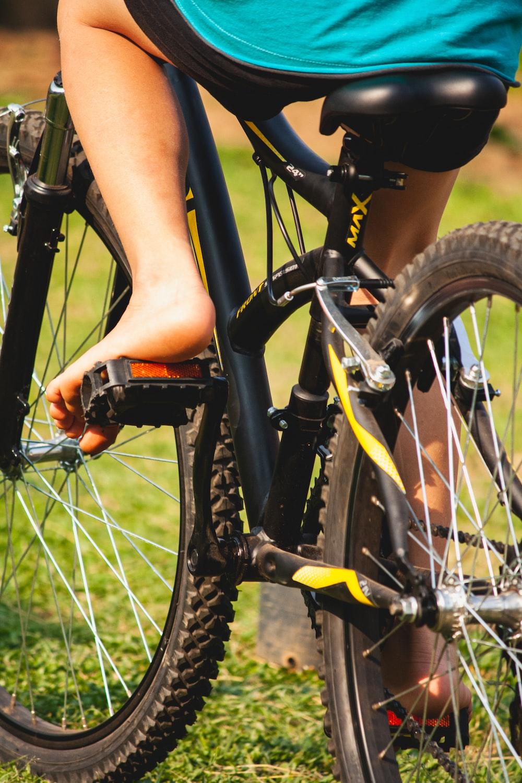 black and orange bicycle wheel