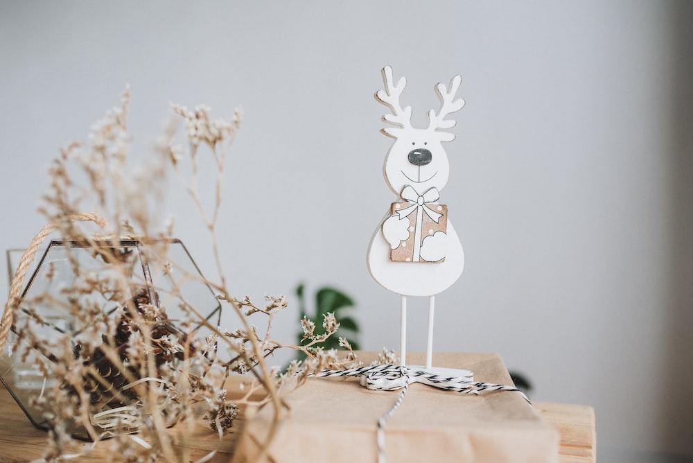 white rabbit on tree branch