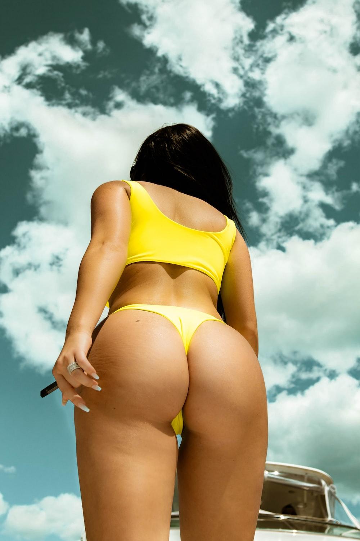 woman in yellow bikini bottom