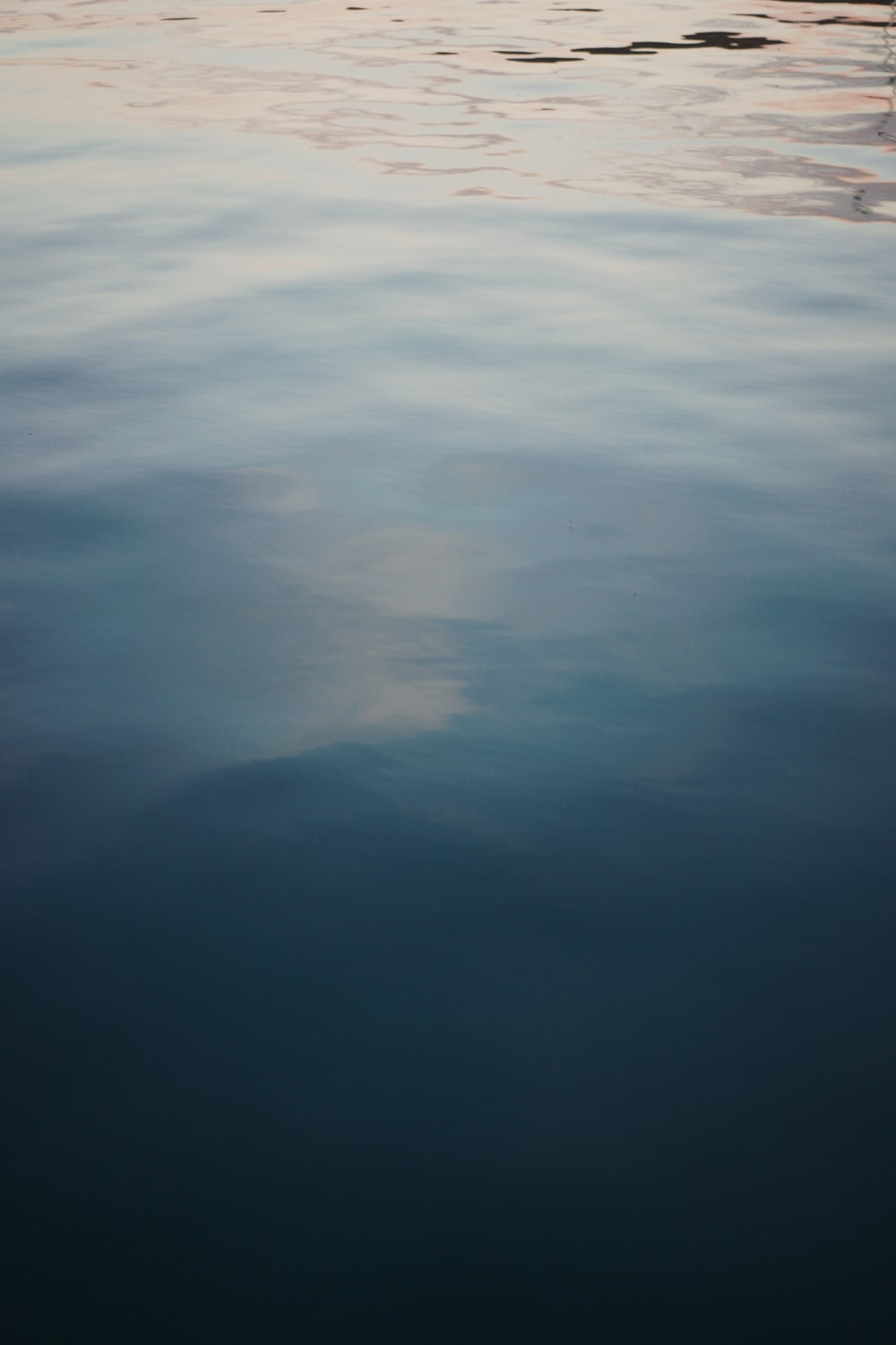 blue and white body of water