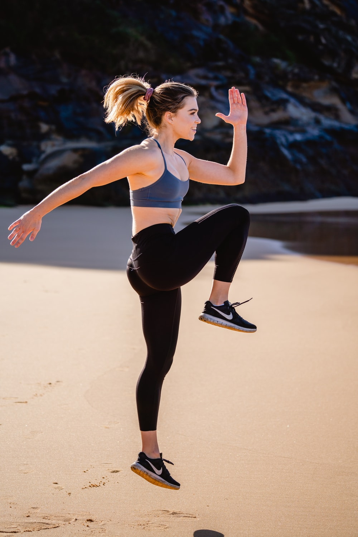 woman in black leggings and white sports bra