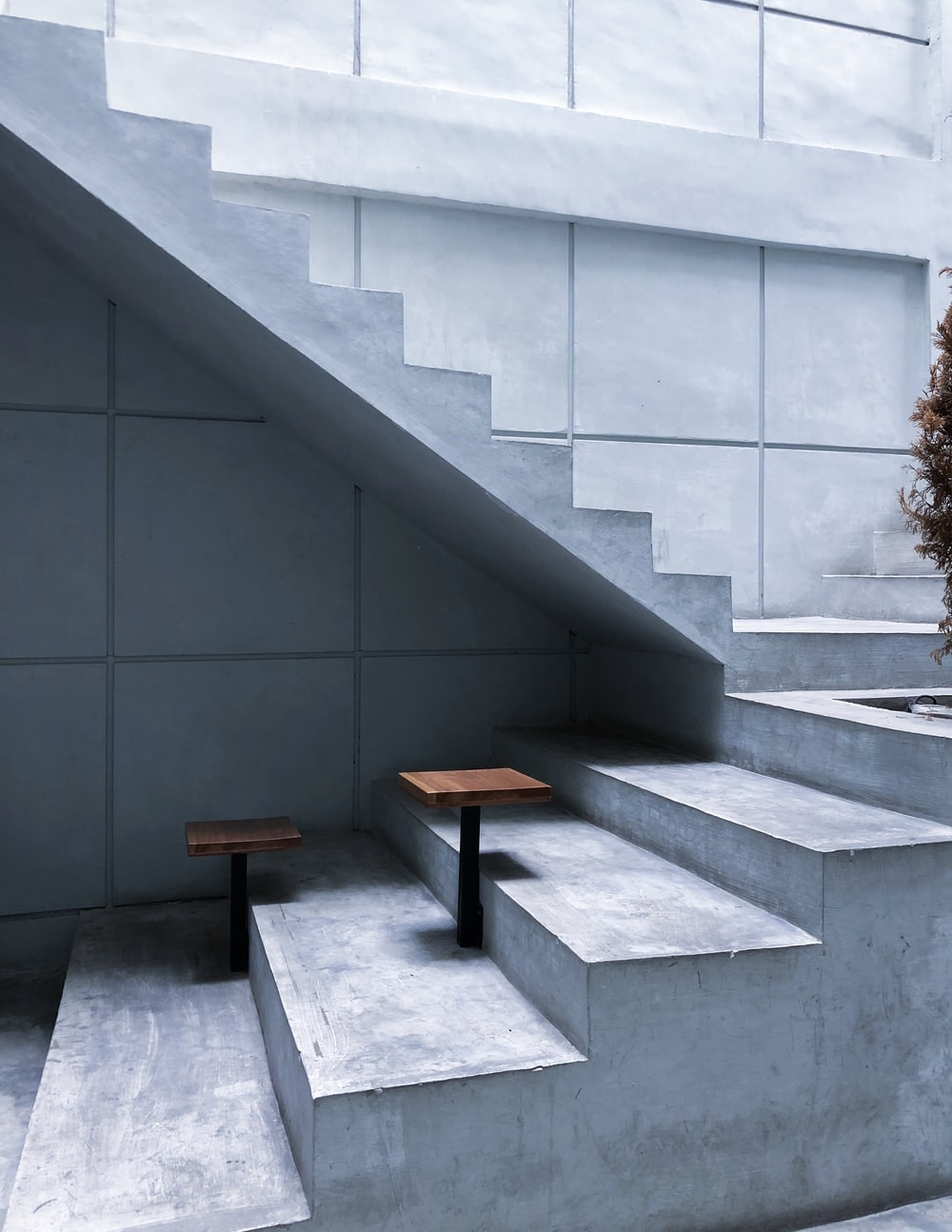 brown wooden table on gray concrete stairs