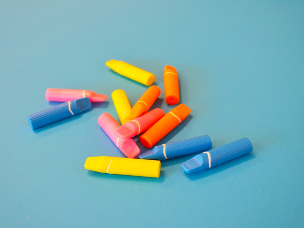 blue red yellow and pink plastic tube