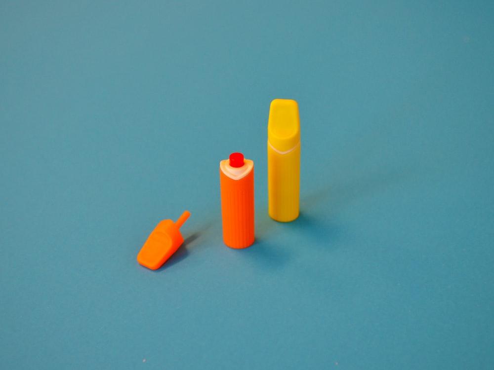 yellow and orange plastic tools