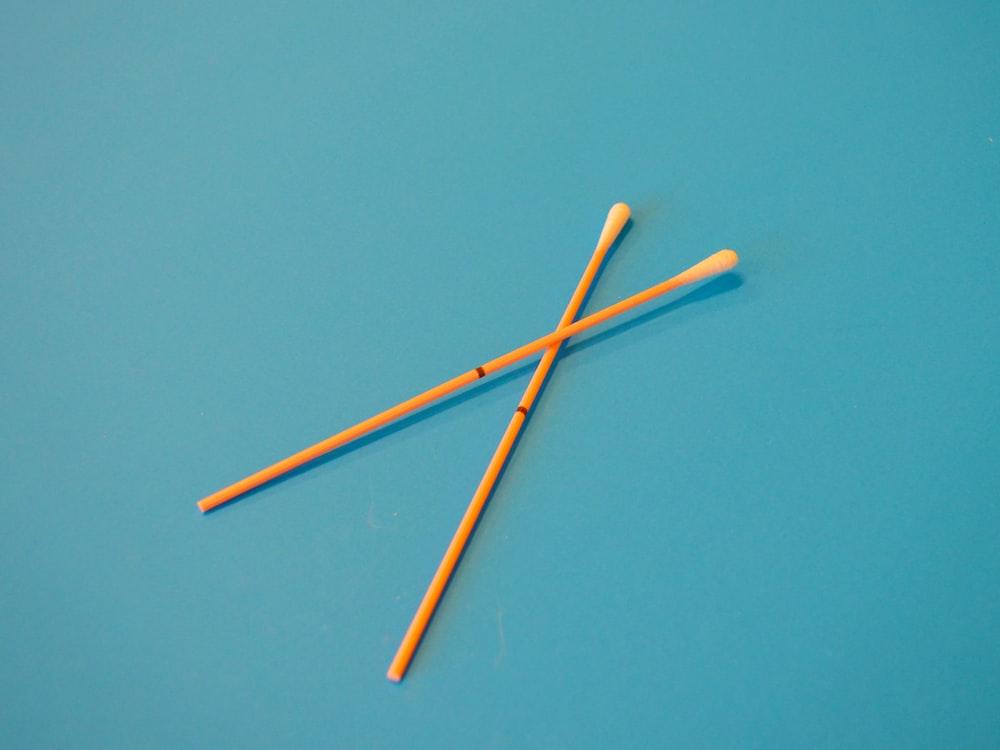 brown wooden sticks on blue surface