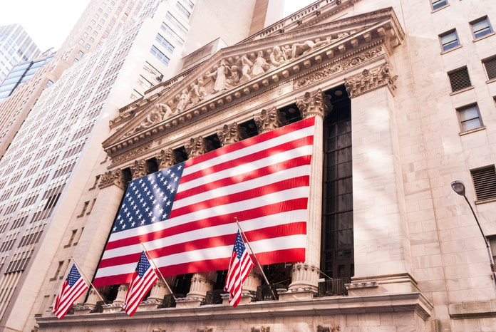 us a flag on top of building