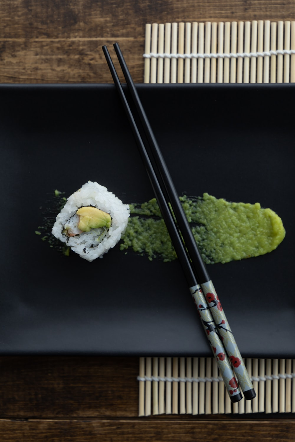 white and green sushi on black table