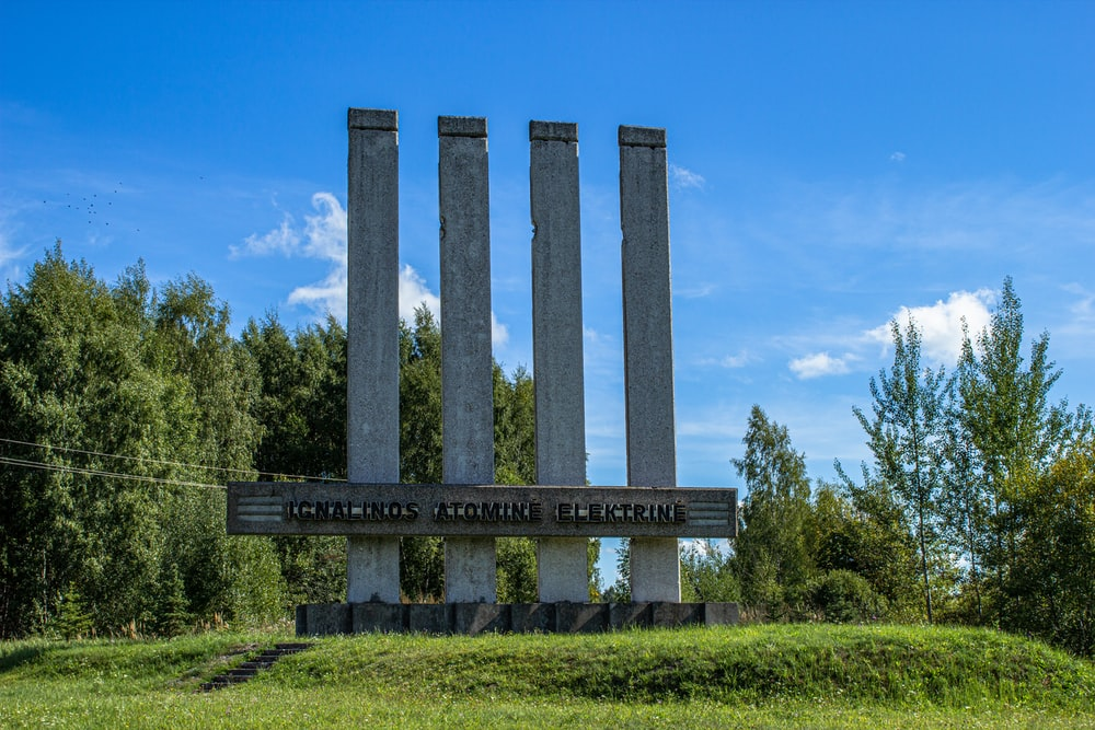 gray concrete pillar on green grass field during daytime