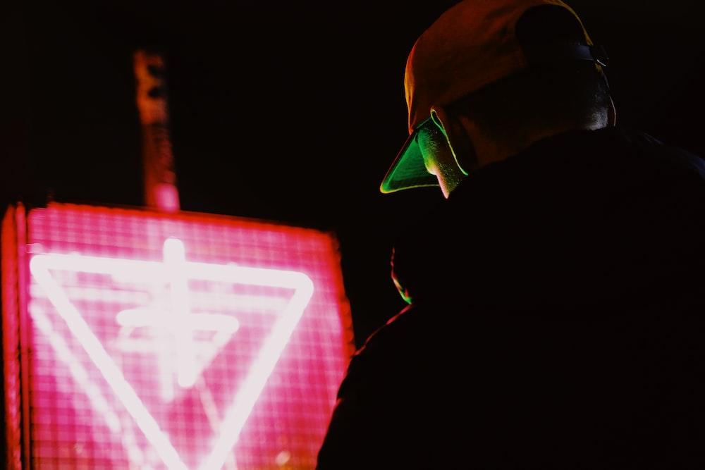 man in black jacket wearing green helmet