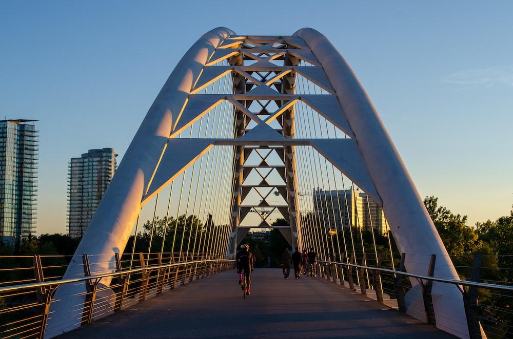 people walking on white bridge during daytime