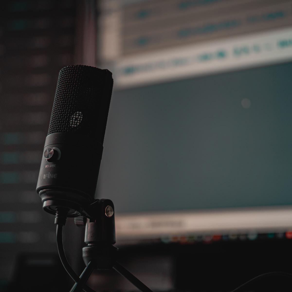 black microphone on black microphone stand