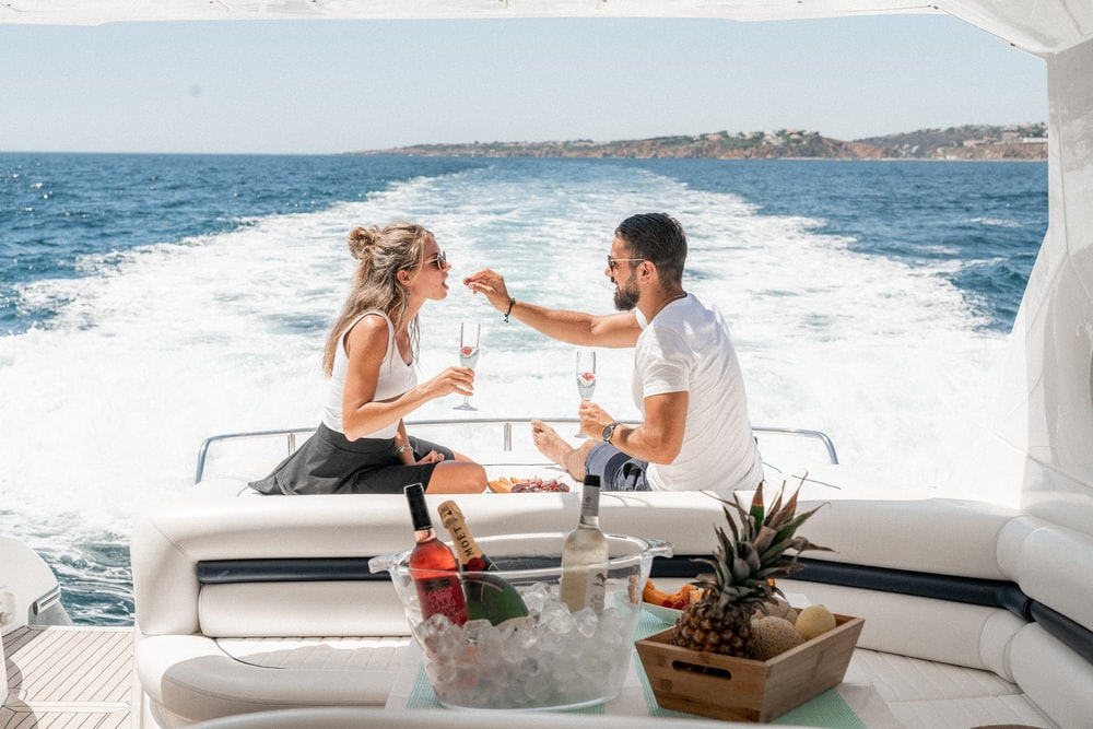 couple sitting on white boat during daytime