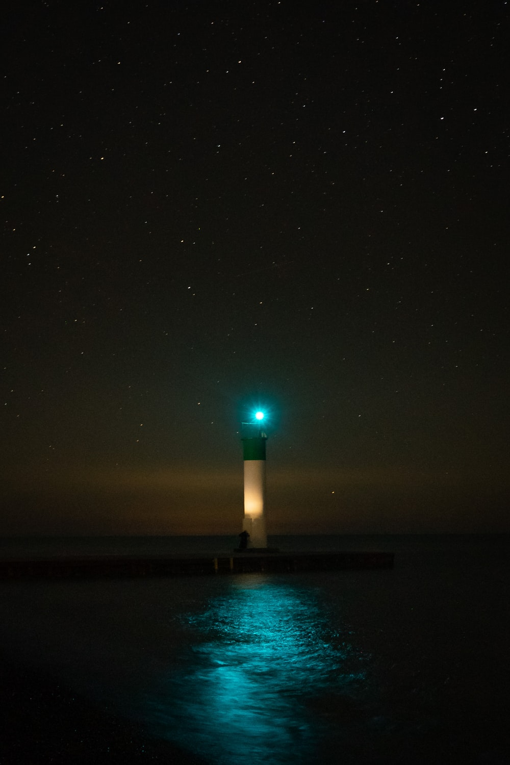 lighted lighthouse during night time