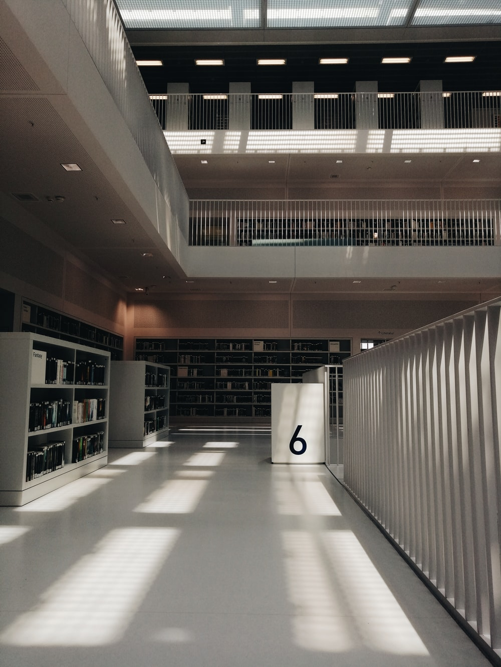 white wooden book shelf in library