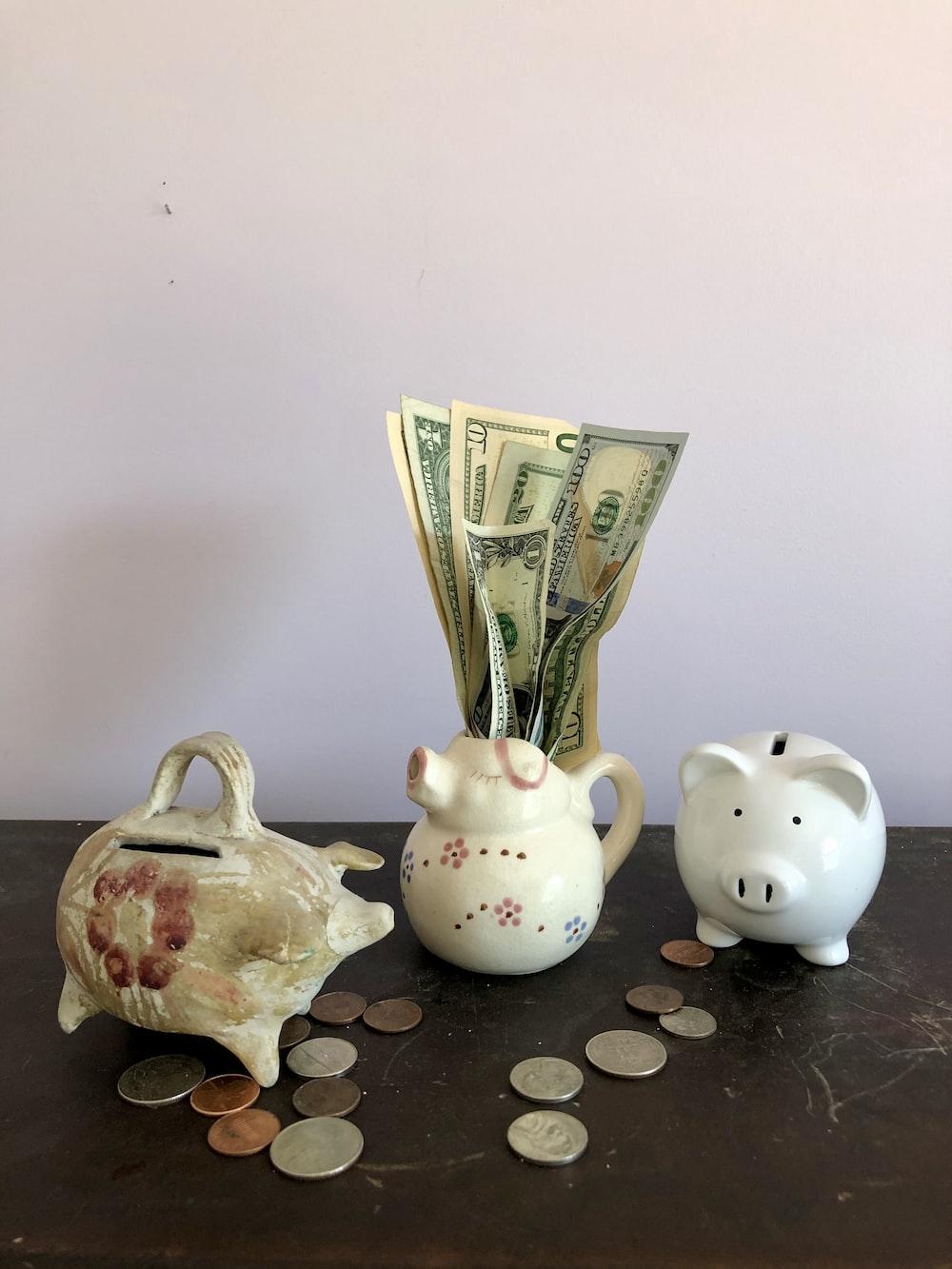 white ceramic teapot beside white ceramic teapot