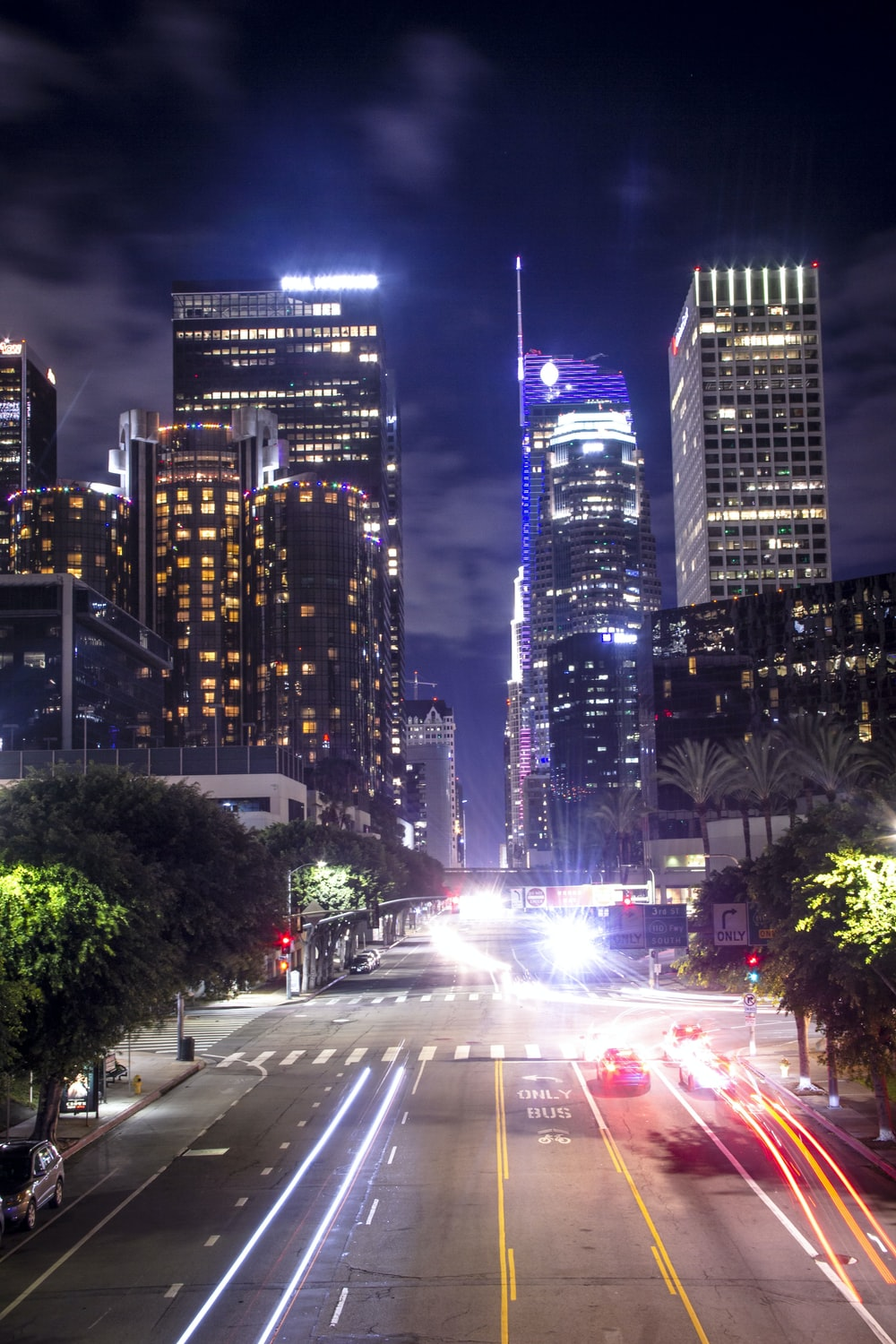 city buildings with lights turned on during night time