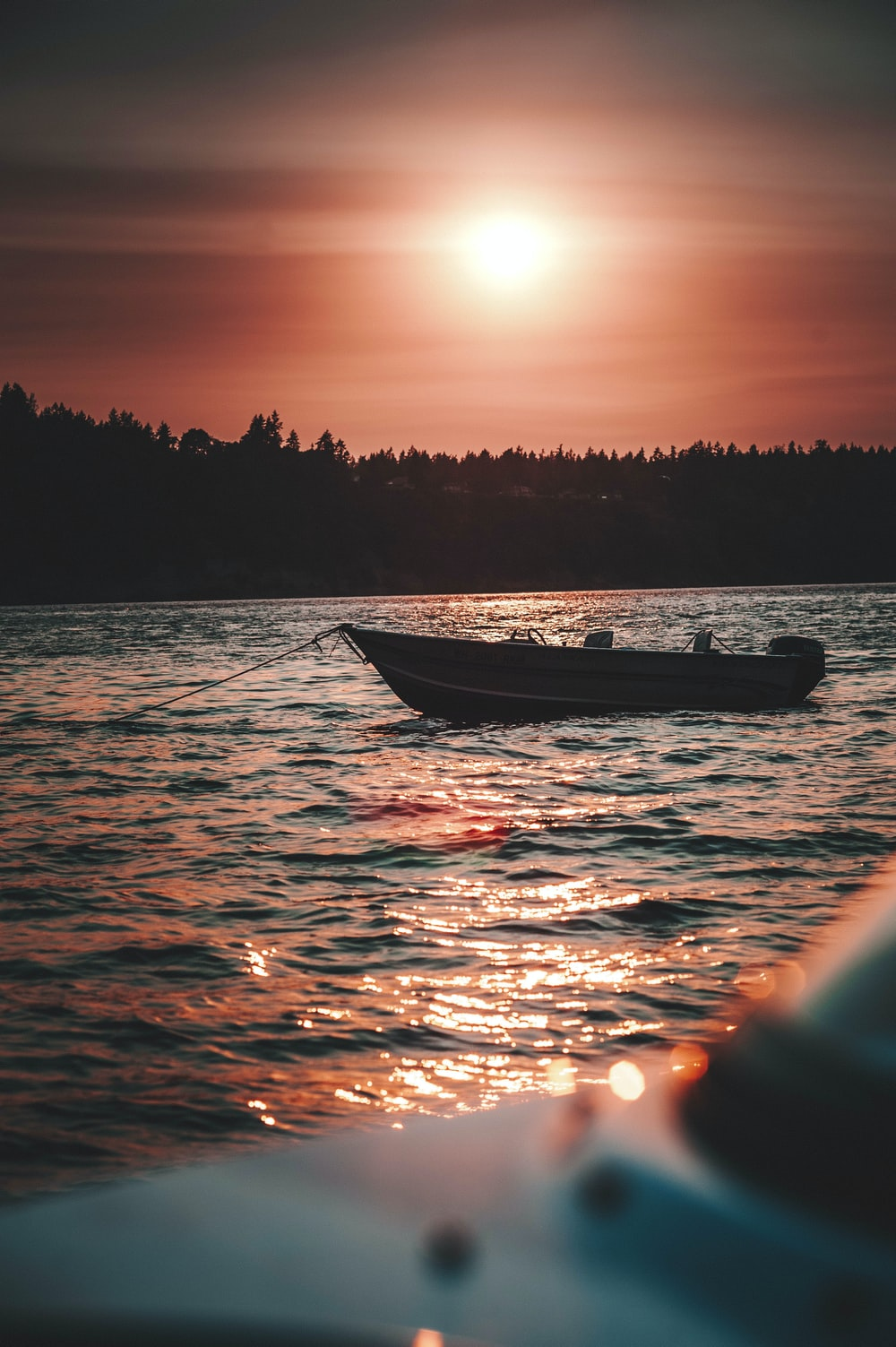 silhouette of person riding on boat during sunset