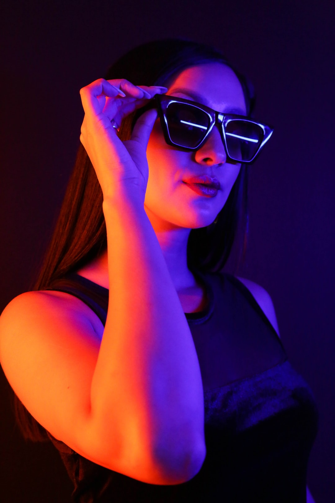 Woman in black dress with sun glasses