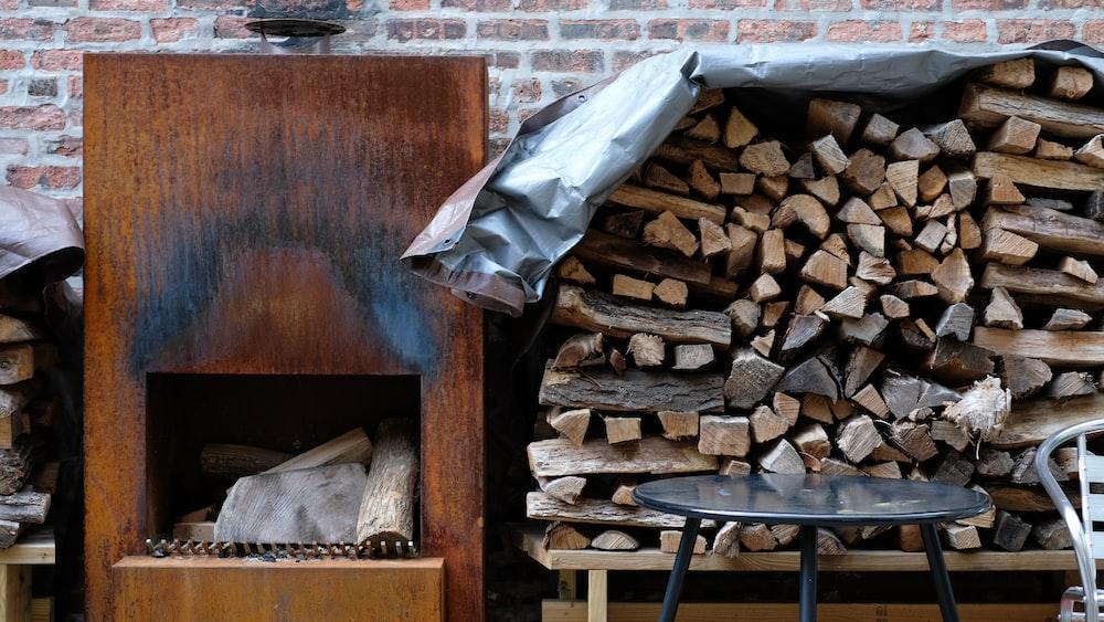 brown firewood on black metal rack