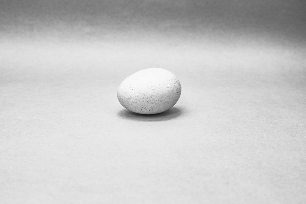 white egg on white table
