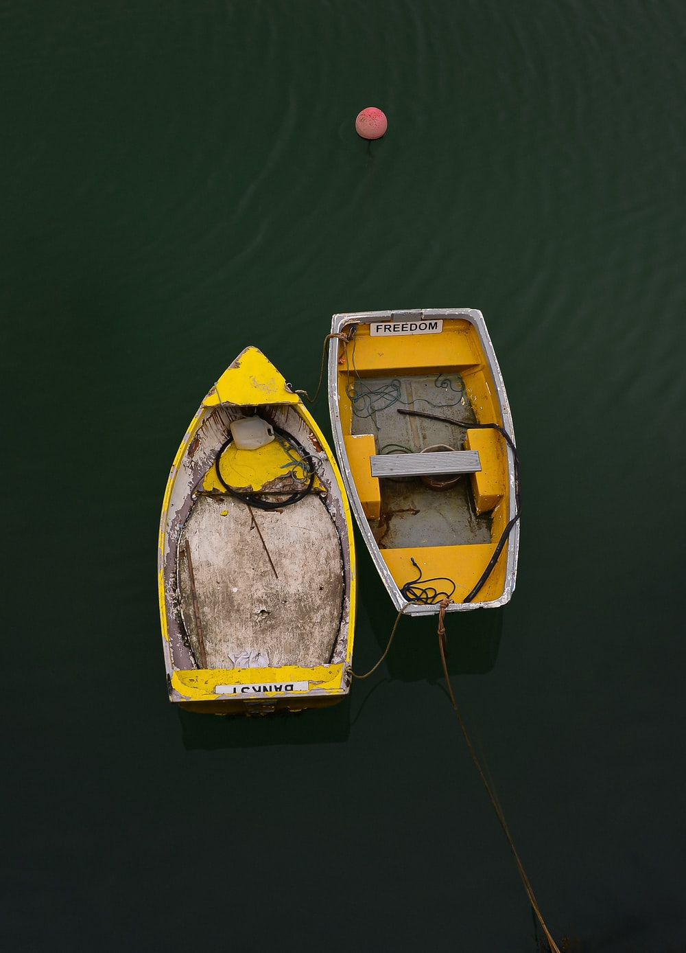 yellow and white boat on water